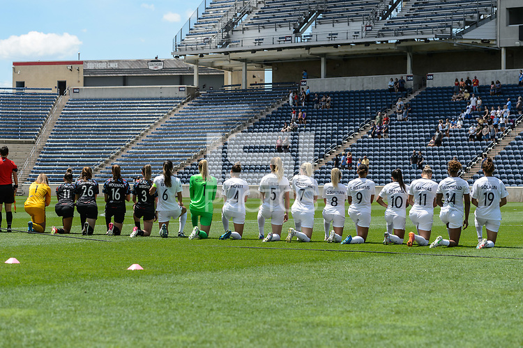 BRIDGEVIEW, IL - JUNE 5: Chicago Red Stars Starting XI and North Carolina Courage Starting XI kneel during the national anthem before a game between North Carolina Courage and Chicago Red Stars at SeatGeek Stadium on June 5, 2021 in Bridgeview, Illinois.