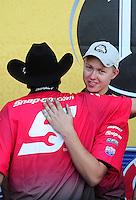 Sept. 25, 2011; Ennis, TX, USA: NHRA funny car driver Cruz Pedregon celebrates with crew members after winning the Fall Nationals at the Texas Motorplex. Mandatory Credit: Mark J. Rebilas-