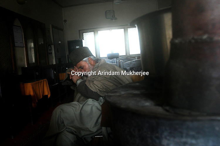 A Kashmir muslim in pensive mood after a news was about the death of a militant commander was flashed on TV, in a local hotel in Srinagar, Kashmir India.
