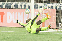 FOXBOROUGH, MA - NOVEMBER 1: Bill Hamid #24 of DC United dives to save the penalty shot which ricocheted off the post during a game between D.C. United and New England Revolution at Gillette Stadium on November 1, 2020 in Foxborough, Massachusetts.