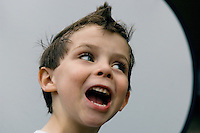 Young boy with spiked hair.
