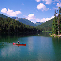 Manning Provincial Park, Southwestern BC, British Columbia, Canada - Canoes canoeing on Lightning Lake