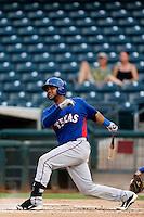 Fernando Vivili #66 of the AZL Rangers bats against the AZL Royals at Surprise Stadium on July 15, 2013 in Surprise, Arizona. AZL Rangers defeated the AZL Royals, 3-2. (Larry Goren/Four Seam Images)