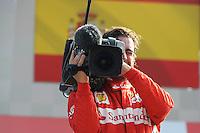 FERRARI SPANISH DRIVER FERNANDO ALONSO PLAYING WITH FOM TV CAMERA ON PODIUM AFTER FINISHING THIRD .Monza 9/9/2012 .Formula 1.Foto Insidefoto / Bernard Asset / Panoramic .Italy Only