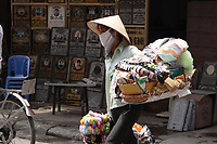 Hanoi<br /> , Vietnam - 2007 File Photo -<br /> <br /> A woman wearing a scarf to protect from pollution carries a basket loaded with  items for sale, in Hanoi.<br /> <br /> <br /> <br /> photo : James Wong-  Images Distribution