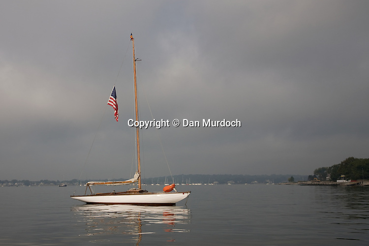 A classic sailboat in the morning light