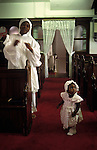 Black British church service mother and daughter spiritual holy dancing Brotherhood of the Cross and Star London 1990s UK  <br /> <br /> This semi Christian church was founded by Olumba Olumba Obu. from A STORM IS PASSING OVER a Look at Black Churches in Britain. Published by Thames and Hudson isbn 0 500 27826 1