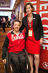 Calgary, AB - June 5 2014 - Josh Dueck with Monique Giroux of CIBC during the Celebration of Excellence Paralympic Ring Reception in Calgary. (Photo: Matthew Murnaghan/Canadian Paralympic Committee)