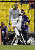 MEXICO CITY, MEXICO - AUGUST 15, 2012:  Tim Howard (1) of the USA MNT is hit by a laser pointer against  Mexico during an international friendly match at Azteca Stadium, in Mexico City, Mexico on August 15. USA won 1-0.