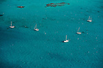 Sailboats floating in the Carrbbean ocean in the Turks and Caicos Islands.