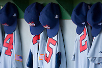 Team USA caps and jerseys hang in the dugout at the USA Baseball National Training Center, September 4, 2009 in Cary, North Carolina.  (Photo by Brian Westerholt / Four Seam Images)