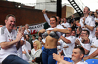 Pictured: A female Swansea supporter shows her breasts at the end of the game<br />