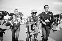 a happy fresh national champion Jens Debusschere (BEL/Lotto-Belisol) escorted back to the podium<br /> <br /> Belgian Championships 2014 - Wielsbeke<br /> Elite Men