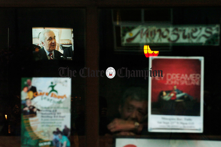 Making the news.... The taoiseach Bertie Ahern is seen through the window of Minogues pub on the TV as locals await his arrival in the flesh at Tulla as part of his tour of Clare. Photograph by John Kelly.