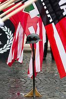 """UNGARN, 13.02.2016, Budapest - I. Bezirk.  Gedenken des Ausbruchsversuchs deutscher und ungarischer Stadtverteidiger unter sowjetischer Belagerung am 11. Februar 1945 auf dem Kapisztrán-Platz vor dem Kriegsmuseum. Der blutig missglueckte Ausbruch gilt bei den Nazis als """"Tag der Ehre"""". -Der im Mittelpunkt eines jeden Gedenkens stehende Stahlhelm mit Flaggen der """"Hungaristischen Bewegung"""" und der """"Ungarischen Nationalen Front"""" MNA.   Commemoration of the breakout attempt by German and Hungarian city defenders under Soviet siege, 1945 February 11 on the Kapisztran square in front of the war museum. Nazis regard the fatally failed breakout as """"Day of Honor"""". -The steel helmet forms the centre of any such commemoration, here together with flags of the  """"Hungarist Movement"""" and the """"Hungarian National Front"""" MNA.<br /> © Martin Fejer/EST&OST"""