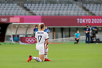 TOKYO, JAPAN - JULY 22: Abby Dahlkemper #17 of the United States takes the knee before a game between Sweden and USWNT at Tokyo Stadium on July 22, 2021 in Tokyo, Japan.