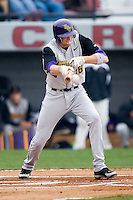 East Carolina Pirates Ryan Wood (16) lays down a bunt at Sarge Frye Field in Columbia, SC, Sunday, February 24, 2008.