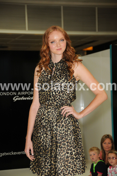 **ALL ROUND PICTURES FROM SOLARPIX.COM**.**WORLDWIDE SYNDICATION RIGHTS**.British model Lily Cole on the runway at Gatwick Fashion Week launch, Gatwick Airport, Sussex, UK.This pic:   Lily Cole.JOB REF:   11856     MSR    DATE:    06.08.10.**MUST CREDIT SOLARPIX.COM OR DOUBLE FEE WILL BE CHARGED**.**MUST NOTIFY SOLARPIX OF ONLINE USAGE**.**CALL US ON: +34 952 811 768 or LOW RATE FROM UK 0844 617 7637**