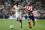 Real Madrid's Chicharito (L) and Atletico del Madrid´s Juanfran during quarterfinal second leg Champions League soccer match at Santiago Bernabeu stadium in Madrid, Spain. April 22, 2015. (ALTERPHOTOS/Victor Blanco)