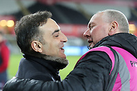 Swansea manager Carlos Carvalhal with Steve, Sheffield Wednesday photographer during The Emirates FA Cup Fifth Round Replay match between Swansea City and Sheffield Wednesday at the Liberty Stadium, Swansea, Wales, UK. Tuesday 27 February 2018