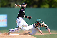 Kentucky Wesleyan Panthers second baseman Josh Vance (2) throws to first as Alex Bell (14) attempts to break up the double play during a game against Slippery Rock University at Jack Russell Stadium on March 14, 2014 in Clearwater, Florida.  Slippery Rock defeated 18-13.  (Mike Janes/Four Seam Images)