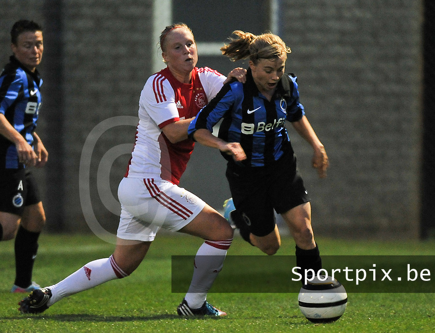 20130830 - VARSENARE , BELGIUM : Brugge's Yana Haesebroek pictured being pushed by Ajax' Linda Bakker during the female soccer match between Club Brugge Vrouwen and Ajax Amsterdam Dames , of the first matchday in the BENELEAGUE competition. Friday 30 August 2013. PHOTO DAVID CATRY