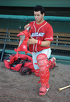 Catcher Sebastian Valle (9) of the Lakewood BlueClaws puts on his gear before a game against the Greenville Drive on May 13, 2010, at Fluor Field at the West End in Greenville, S.C. Photo by: Tom Priddy/Four Seam Images