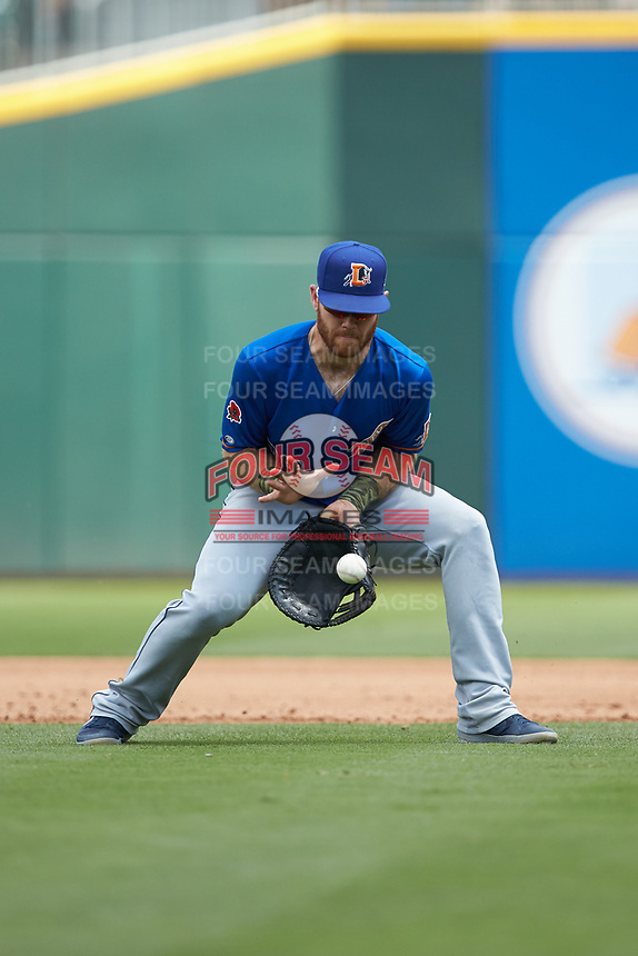 Durham Bulls first baseman Mac James (28) fields a ground ball during the game against the Charlotte Knights at BB&T BallPark on May 27, 2019 in Charlotte, North Carolina. The Bulls defeated the Knights 10-0. (Brian Westerholt/Four Seam Images)