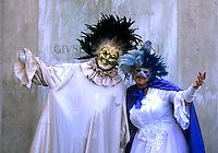 Tourists celebrating in costume party in picturesque Venice Ital