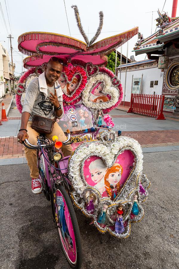 Malaysian Driver with his Trishaw, Popular among Tourists as an Alternative to Walking.  Melaka, Malaysia.