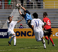 Quillan Roberts (18) of Canada pulls in a save during the group stage of the CONCACAF Men's Under 17 Championship at Catherine Hall Stadium in Montego Bay, Jamaica. Canada tied Honduras, 0-0.