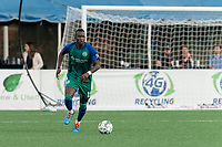 HARTFORD, CT - AUGUST 17: Tulu #15 of Hartford Athletic brings the ball forward during a game between Charleston Battery and Hartford Athletic at Dillon Stadium on August 17, 2021 in Hartford, Connecticut.