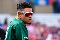 Great Lakes Loons outfielder Romer Cuadrado (25) looks on from the dugout during a Midwest League game against the Wisconsin Timber Rattlers on May 12, 2018 at Fox Cities Stadium in Appleton, Wisconsin. Wisconsin defeated Great Lakes 3-1. (Brad Krause/Four Seam Images)
