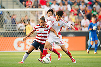 Carli Lloyd (10) of the United States (USA) battles for the ball with Zhang Rui (25) of China PR (CHN). The United States (USA) women defeated China PR (CHN) 4-1 during an international friendly at PPL Park in Chester, PA, on May 27, 2012.