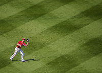 26 April 2014: Washington Nationals outfielder Kevin Frandsen pulls in a Yonder Alonso fly in the 7th inning against the San Diego Padres at Nationals Park in Washington, DC. The Nationals shut out the Padres 4-0 to take the third game of their 4-game series. Mandatory Credit: Ed Wolfstein Photo *** RAW (NEF) Image File Available ***