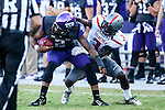 TCU Horned Frogs quarterback Trevone Boykin (2) and Texas Tech Red Raiders defensive back J.J. Gaines (3) in action during the game between the Texas Tech Red Raiders and the TCU Horned Frogs at the Amon G. Carter Stadium in Fort Worth, Texas. TCU defeats Texas Tech 82 to 27.