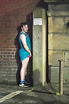 © Joel Goodman - 07973 332324 . 27/12/2016 . Wigan , UK . A man in a dress urinates against a wall . Revellers in Wigan enjoy Boxing Day drinks and clubbing in Wigan Wallgate . In recent years a tradition has been established in which people go out wearing fancy-dress costumes on Boxing Day night . Photo credit : Joel Goodman