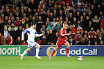 UEFA European Championship at Cardiff City Stadium - Wales v Cyprus : <br /> George Williams of Wales is chased by Vincent Laban of Cyprus.