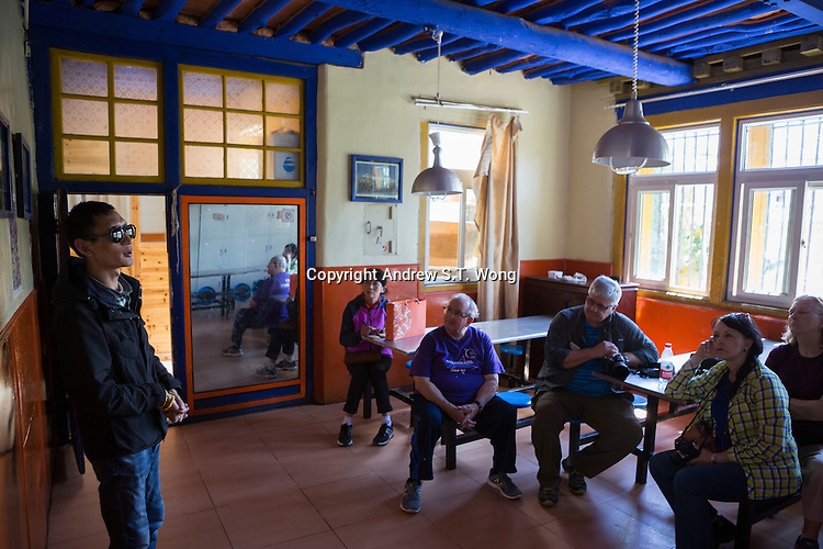 Blind Tibetan Headmaster Nyima Wangdu of the School for the Blind In Tibet briefs visiting American tourists at the school canteen in the capital city of Lhasa, September 2016.