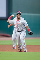 Greenville Drive third baseman Rafael Devers (13) makes a throw to first base against the Greensboro Grasshoppers at NewBridge Bank Park on August 17, 2015 in Greensboro, North Carolina.  The Drive defeated the Grasshoppers 5-4 in 13 innings.  (Brian Westerholt/Four Seam Images)