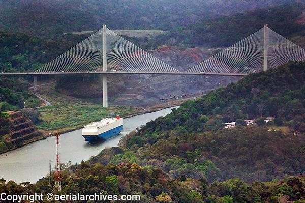aerial photograph of a container ship passing through the Panama Canal at the Centennial Bridge, Panama | fotografía aérea del Puente Centenario, que cruza el Canal de Panamá