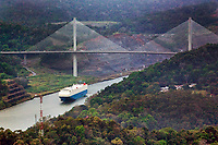 aerial photograph of a container ship passing through the Panama Canal at the Centennial Bridge, Panama | fotografía aérea del Puente Centenario, que cruza el Canal de Panamá