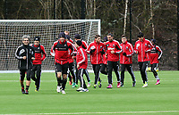 Tuesday 15 January 2013<br /> Pictured: Players warming up led by top scorer Michu (FRONT CENTRE)<br /> Re: Swansea City FC training near the Liberty Stadium ahead of their Cup game against Arsenal at the Emirates Stadium.