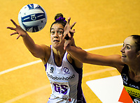 Maia Wilson takes a pass under pressure from Kelly Jury during the ANZ Premiership netball match between Central Pulse and Northern Stars at Auckland Netball Centre in Auckland, New Zealand on Saturday, 25 July 2020. Photo: Dave Lintott / lintottphoto.co.nz