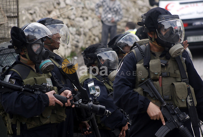 Israeli policemen stand guards during clashes with Palestinian protesters at a demonstration against the closure of Shuhada street to Palestinians, in the West Bank city of Hebron February 24, 2012. Some 200 protesters, including foreign and Israeli activists, gathered on Friday marking the 18th anniversary of the closure of the street, which was closed by the Israeli army in 1994 following the Hebron mosque massacre by Baruch Goldstein, an Israeli settler, who went on a rampage inside Al Ibrahimi Mosque, killing 29 Palestinian worshippers. Photo by Mamoun Wazwaz
