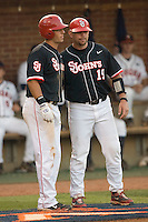 St. John's Red Storm coach Mike Hampton #19 chats with batter Paul Karmas #31 in the championship game of the Charlottesville Regional at Davenport Field on June 7, 2010, in Charlottesville, Virginia.  The Cavaliers defeated the Red Storm 5-3.  Photo by Brian Westerholt / Four Seam Images