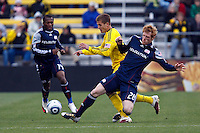 8 MAY 2010:  New England Revolutions' Sainey Nyassi (14), Robbie Rogers of the Columbus Crew (19) and New England Revolutions' Pat Phelan (28) during MLS soccer game between New England Revolution vs Columbus Crew at Crew Stadium in Columbus, Ohio on May 8, 2010. The Columbus defeated New England 3-2.
