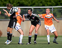 Ashley Herndon (19) and Holly King (16) of the D.C. United Women fight for a touch on the ball in the box with Sarah Ann Waugh (3) and Samantha Huecker (21) of the Charlotte Lady Eagles during the game at the Maryland SoccerPlex in Boyds, Maryland.  The D.C. United Women defeated the Charlotte Lady Eagles, 3-0, to win the W-League Eastern Conference Championship.