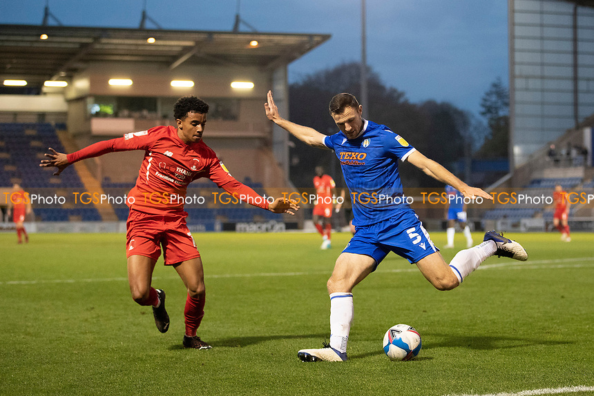 Tommy Smith, Colchester United clears under pressure from Louis Dennis, Leyton Orient during Colchester United vs Leyton Orient, Sky Bet EFL League 2 Football at the JobServe Community Stadium on 14th November 2020