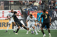 FOXBOROUGH, MA - AUGUST 4: Edgar Castillo #8 of New England Revolution and Carlos Vela #10 of Los Angeles FC clash near the New England goal during a game between Los Angeles FC and New England Revolution at Gillette Stadium on August 3, 2019 in Foxborough, Massachusetts.